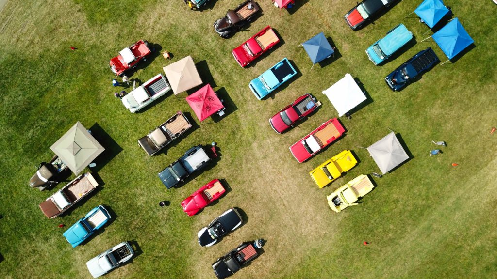 lines of trucks at a car show event