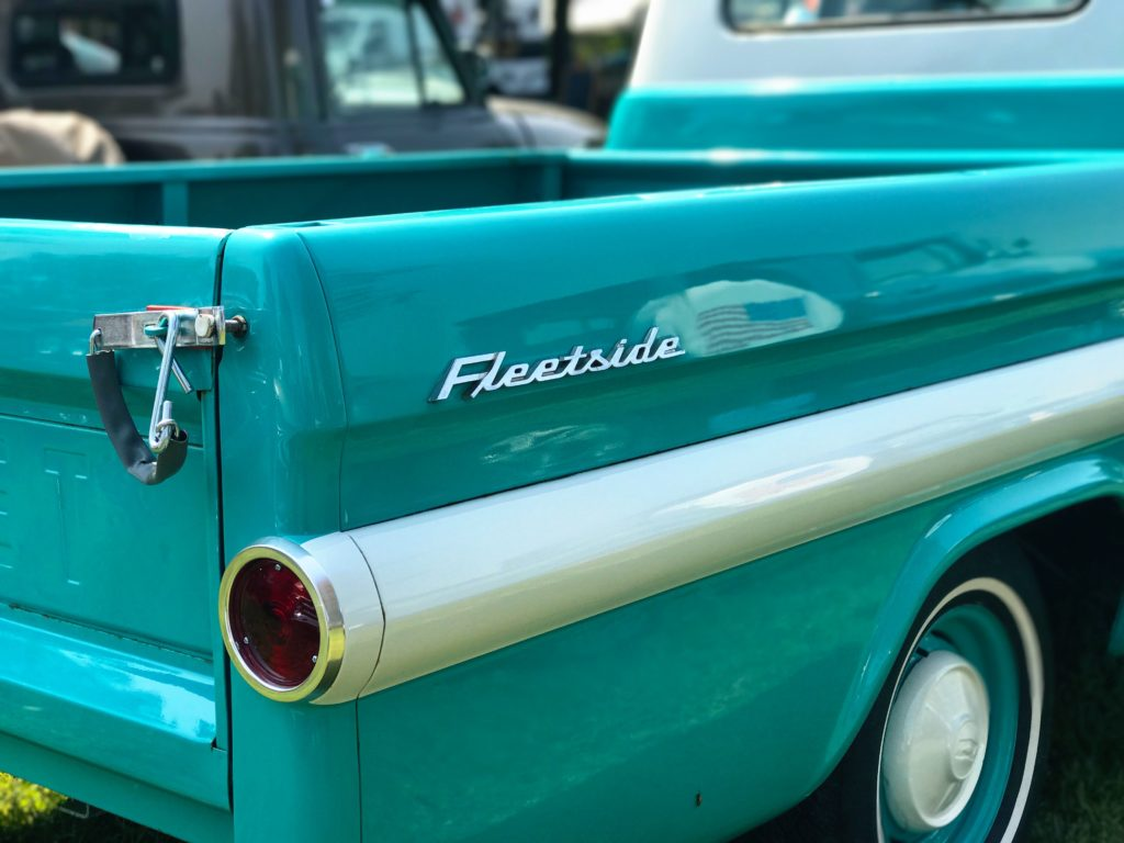 teal and white vintage truck at truck show