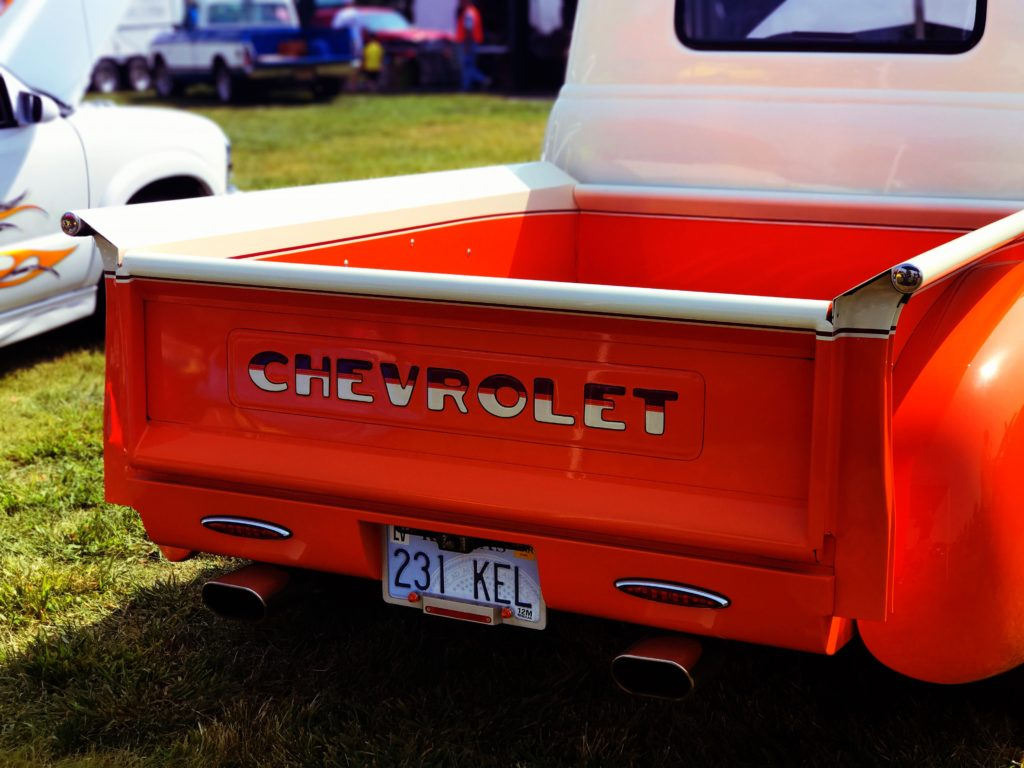 red chevrolet truck in a car show