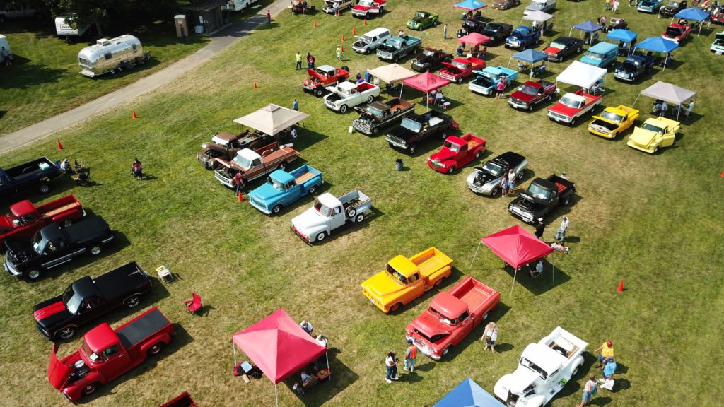 picture of old classic trucks at a car event